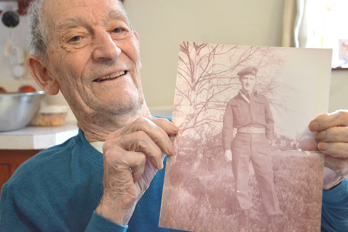 George Lockerby still has a photo of himself in uniform taken in 1945 in England when he was with the Canadian Army. (Heather Colpitts/Langley Advance Times)