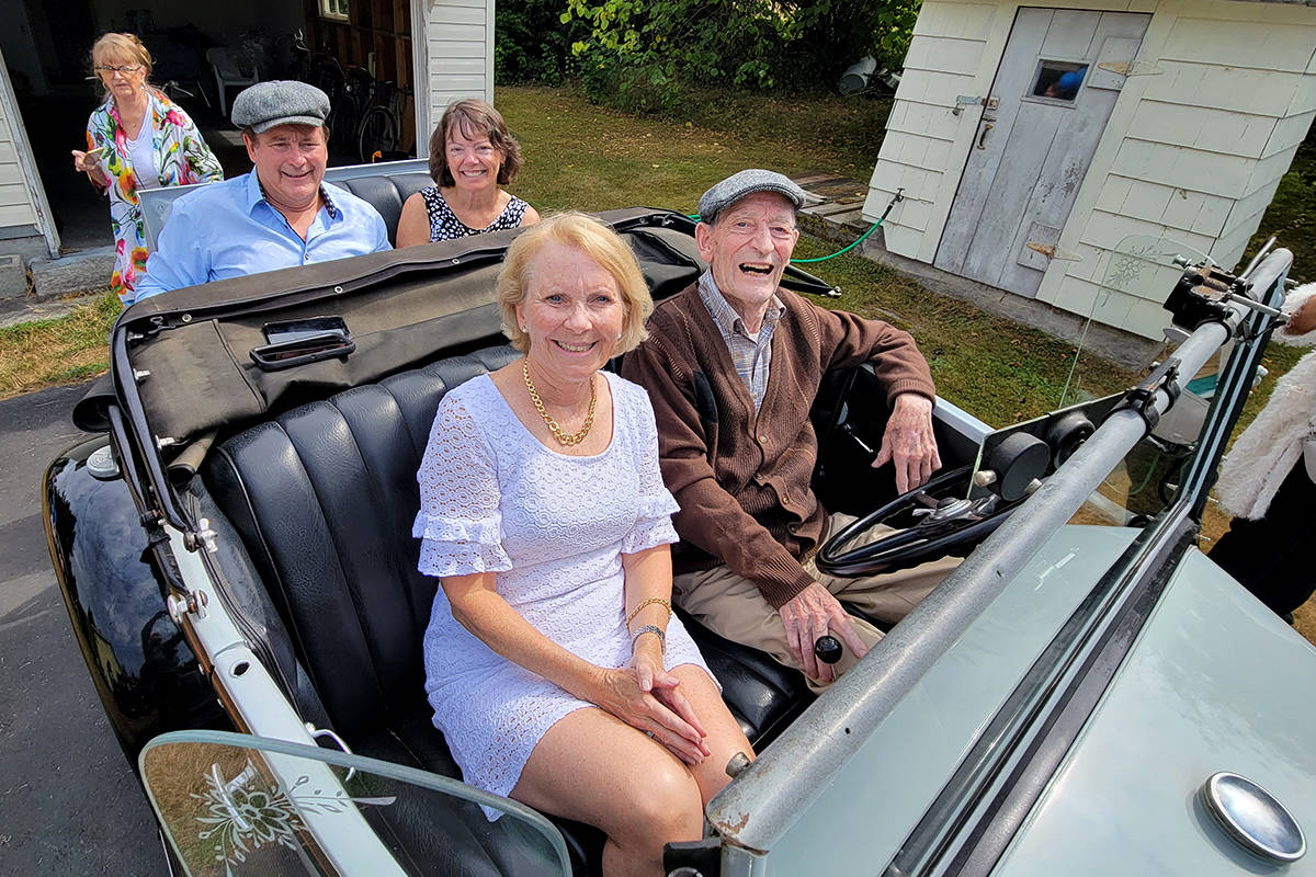 South Langley resident George Lockerby (front right) with daughter Cindy Walker (front left) and son Norman Lockerby (left rear) and daughter Iris Owen (right rear) posed for a photo in a gleaming 1931 Ford Model A roadster to mark his 98th birthday. (Dan Ferguson/Langley Advance Times)