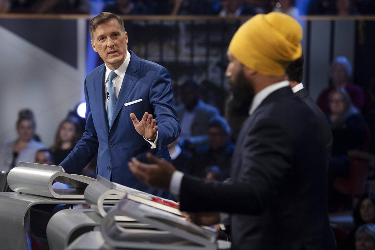 FILE – People's Party of Canada leader Maxime Bernier responds to NDP leader Jagmeet Singh during the Federal leaders debate in Gatineau, Que. on Monday October 7, 2019. THE CANADIAN PRESS/Justin Tang