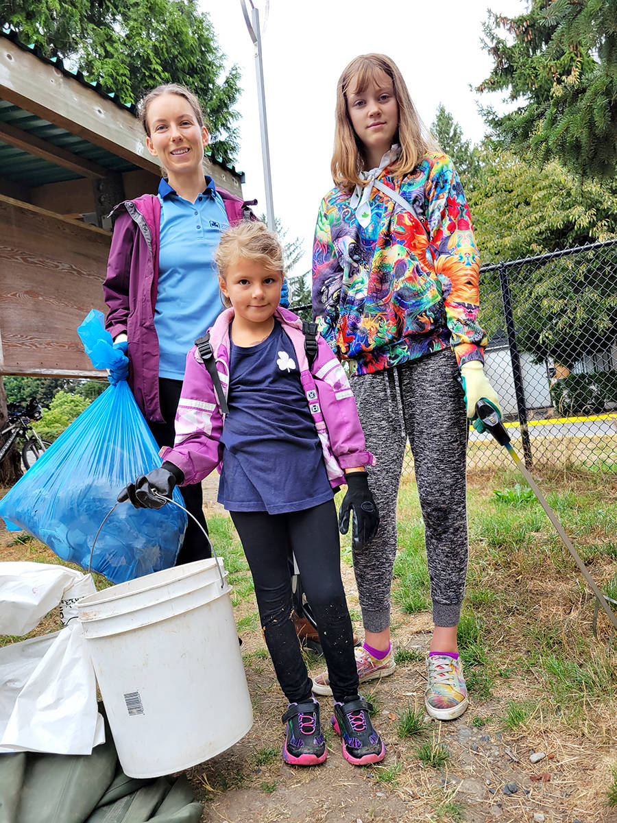 Langley Valley District Girl Guides joined the volunteer effort to clear out trash from the Nicomekl River floodplain in Langley City on Saturday, Aug. 22. Guide leader Bailee Clowes (left), Evalit Smith, Pathfinder (right), and Sophie Pandur, Spark (centre). (Dan Ferguson/Langley Advance Times)