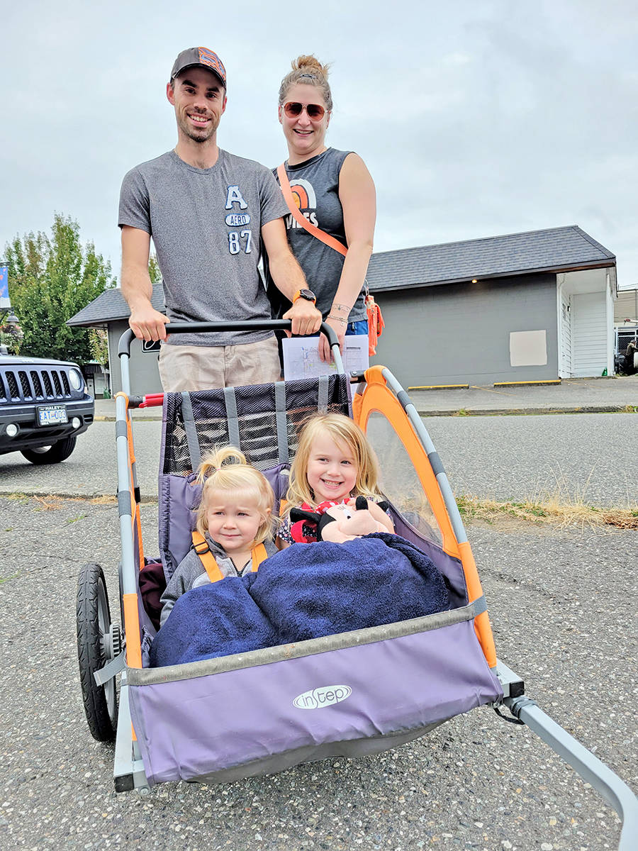 Trevor and Aleta Coop, with Taryn, 3, and Teagan, 4 took part in the third annual giant Aldergrove garage sale held on Saturday, Aug. 22. (Dan Ferguson/Langley Advance Times)
