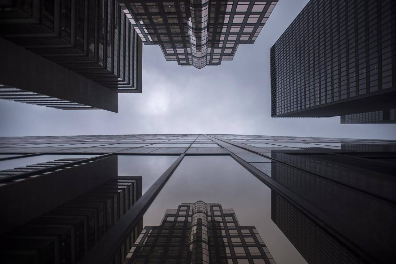 Bank buildings are photographed in Toronto's financial district on Wednesday, June 27, 2018. Canadian banks are emerging from the pandemic flush with cash, but analysts say they'll be looking at financial results out this week for hints of how the sector is transitioning towards more business as usual. THE CANADIAN PRESS/ Tijana Martin