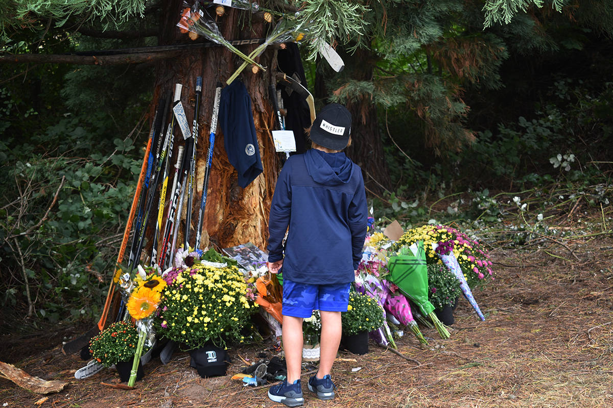 People who knew Caleb Reimer, Ronin Sharma and Parker Magnuson paid their respects at a makeshift memorial Sunday. (Aaron Hinks photo)