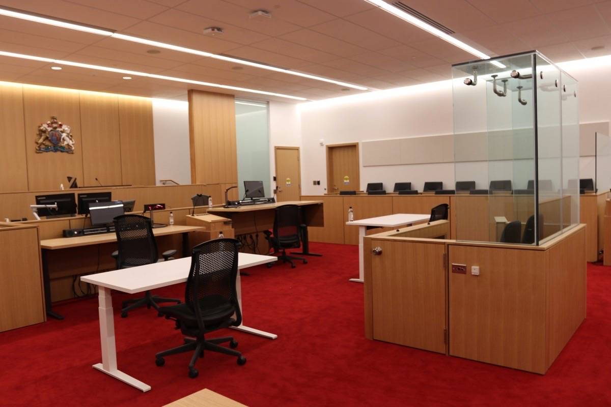 A courtroom in Abbotsford with jury box on the right. Civil jury trials in B.C. are rare, with eight jurors assigned and the agreement of six required to settle a civil matter. (B.C. government photo)