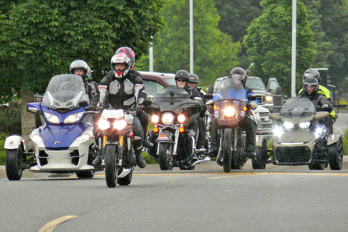 Doug Penner, now 18, was all smiles when the Ride for Doug was able to return – despite the rain – this June in Langley. The Island ride, however, has been postponed for a year. (Langley Advance Times files)