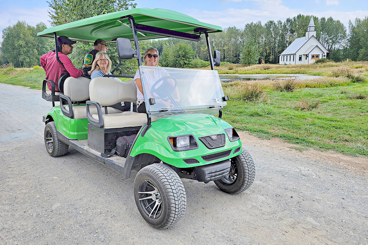 """Melanie MacInnes provided a preview on Sunday, Aug 22, 2021 of the drive-through version of the Aldergrove Fair that will route through her farm, including the standing set of the Hallmark Channel show """"When Calls the Heart"""", visible behind them. (Dan Ferguson/Langley Advance Times)"""