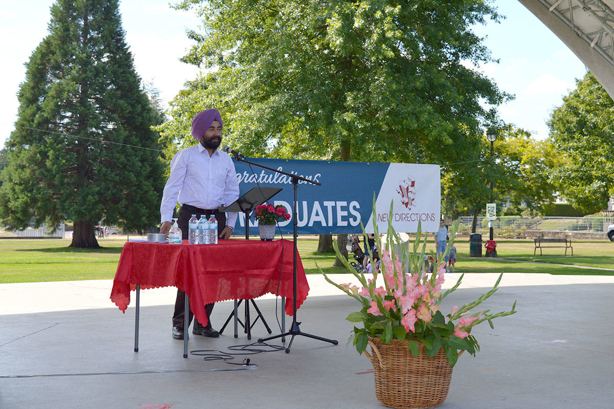 Sarwan Randhawa, FVRL community supervisor, celebrated the grads at New Directions school on Aug. 10, 2021 at Langley City's Douglas Park. (New Directions/Special to Langley Advance Times)