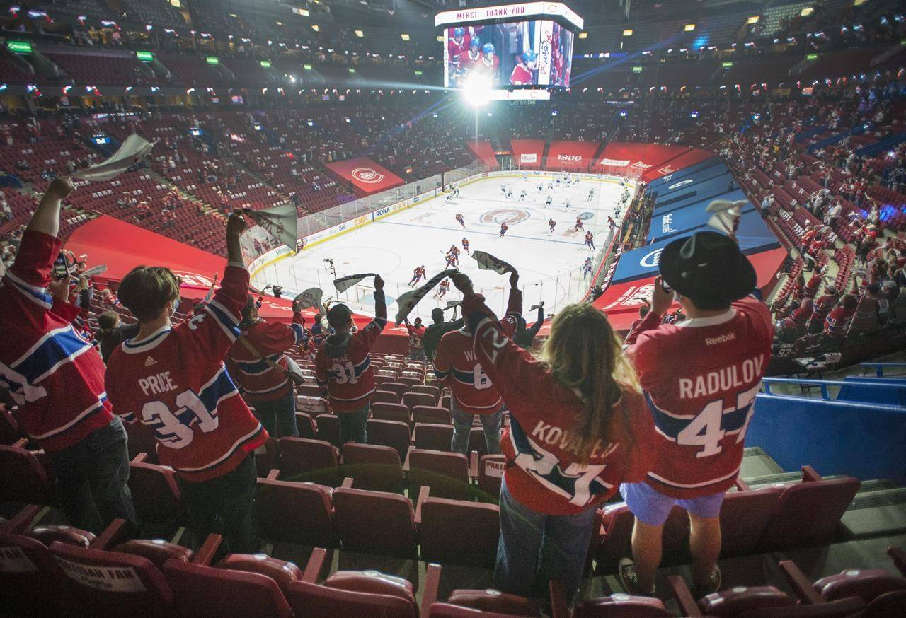 Fans watch the warm-up before Game 6 between the Toronto Maple Leafs and the Montreal Canadiens in NHL playoff hockey action Saturday, May 29, 2021 in Montreal. THE CANADIAN PRESS/Ryan Remiorz