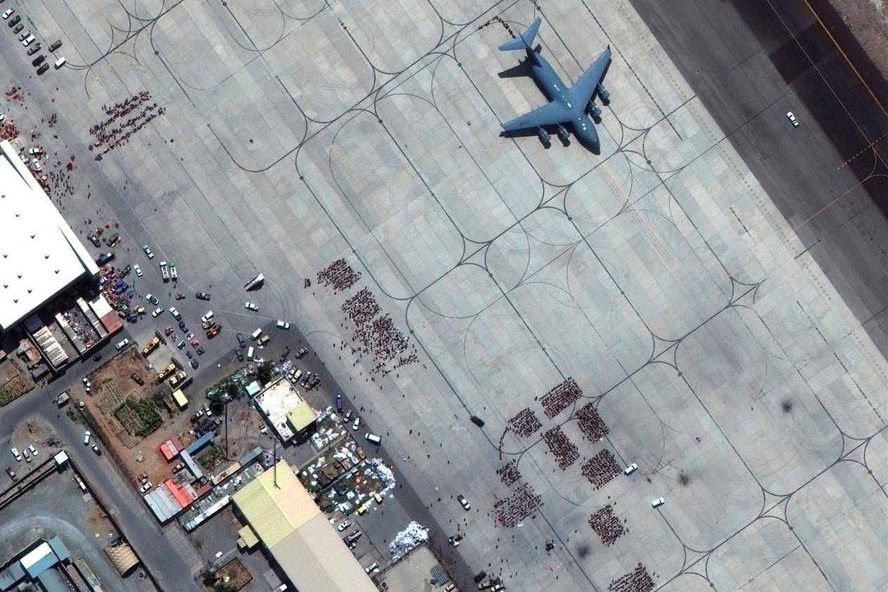 In this satellite photo released by Maxar Technologies, Kabul's international airport is seen amid evacuations on Monday, Aug. 23, 2021. THE CANADIAN PRESS/AP-Satellite image ©2021 Maxar Technologies