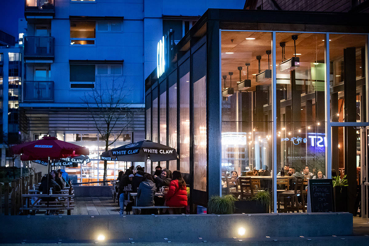 FILE – People dine on a patio at a restaurant in Vancouver, on Friday, April 2, 2021. B.C. has banned indoor dining at restaurants and bars as part of a three-week measure to curb the spread of COVID-19 amid growing concern about the spread of COVID-19 variants. THE CANADIAN PRESS/Darryl Dyck