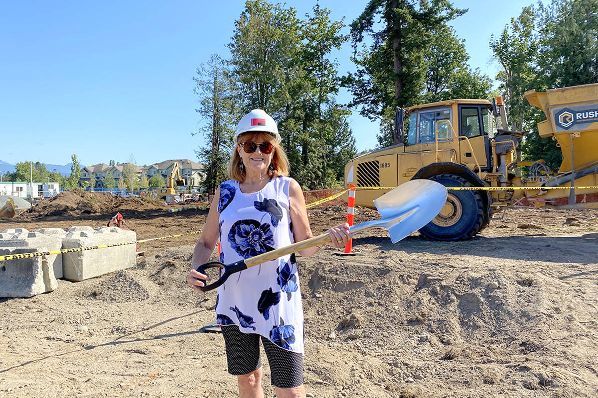 Vivian Smith, former executive director of the Langley Hospital Foundation, who is now involved with the development, marks the ground breaking on the seniors housing project in Murrayville on Aug. 24, 2021. (Joti Grewal/Langley Advance Times)