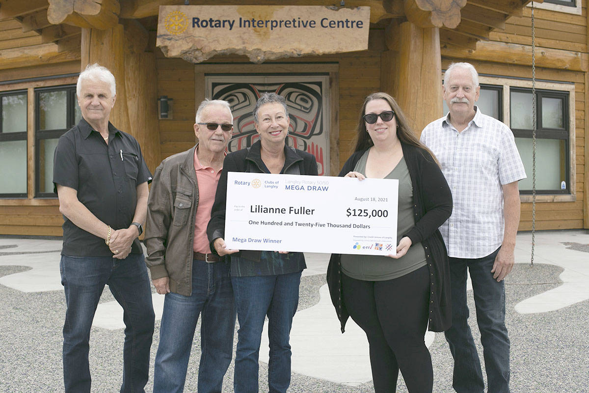 Winners Tony and Lilianne Fuller (second and third from left) met with Rotarians Brian Lott (left), chair Jennifer Roy, and Jeff Morfitt to receive their prize. (Rotary clubs of Langley/Special to the Langley Advance Times)