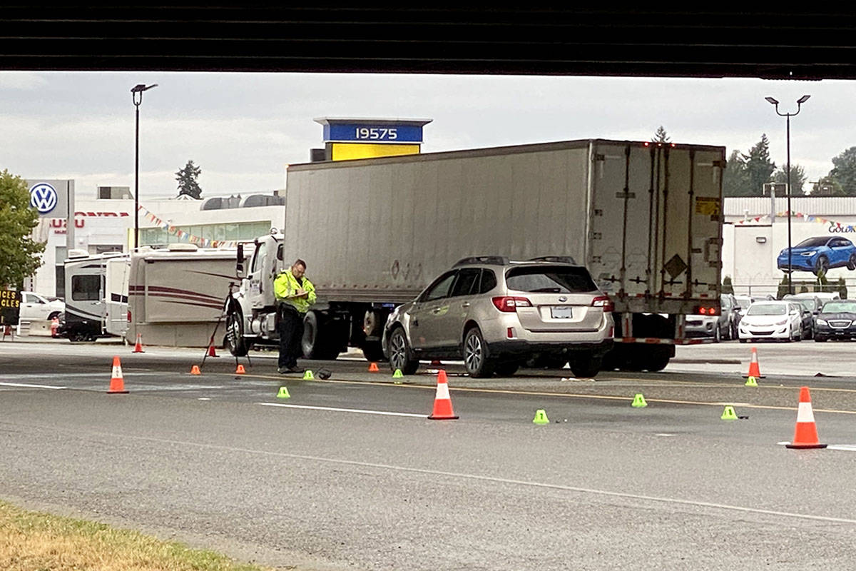 Officers were at the Langley-Surrey border Thursday morning, Aug. 26, 2021 investigating an overnight crash that sent a pedestrian to hospital in serious condition. The driver was travelling eastbound on Highway 10 at 196th Street. (Joti Grewal/Langley Advance Times)