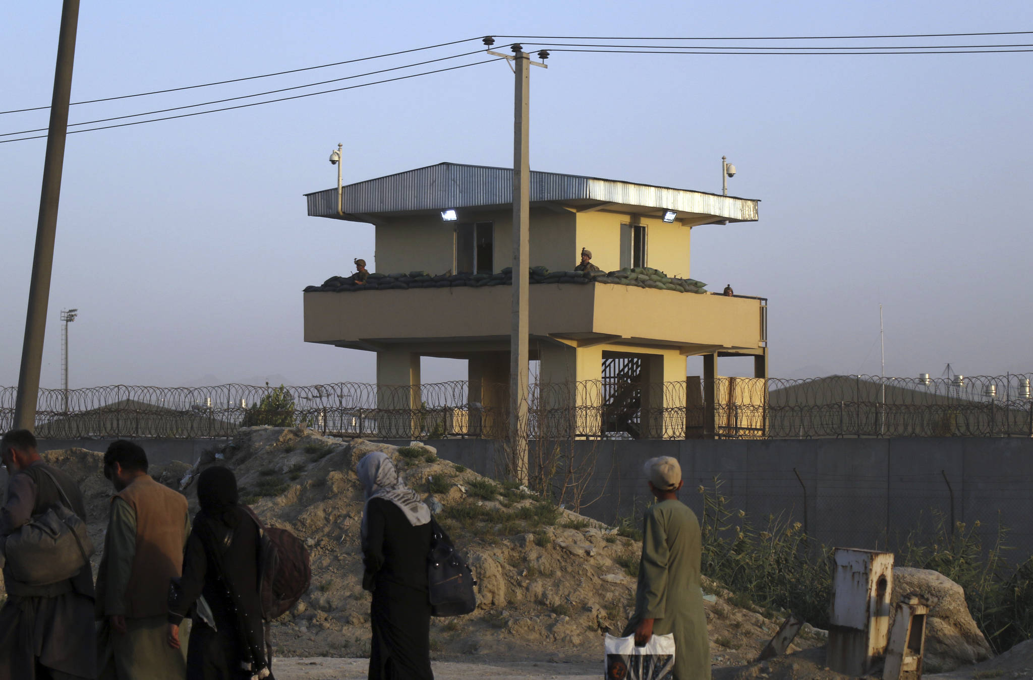 U.S soldiers stand guard at the airport tower near an evacuation control checkpoint during ongoing evacuations at Hamid Karzai International Airport, in Kabul, Afghanistan, Wednesday, Aug. 25, 2021. The Taliban wrested back control of Afghanistan nearly 20 years after they were ousted in a U.S.-led invasion following the 9/11 attacks. Their return to power has pushed many Afghans to flee, fearing reprisals from the fighters or a return to the brutal rule they imposed when they last ran the country. (AP Photo)