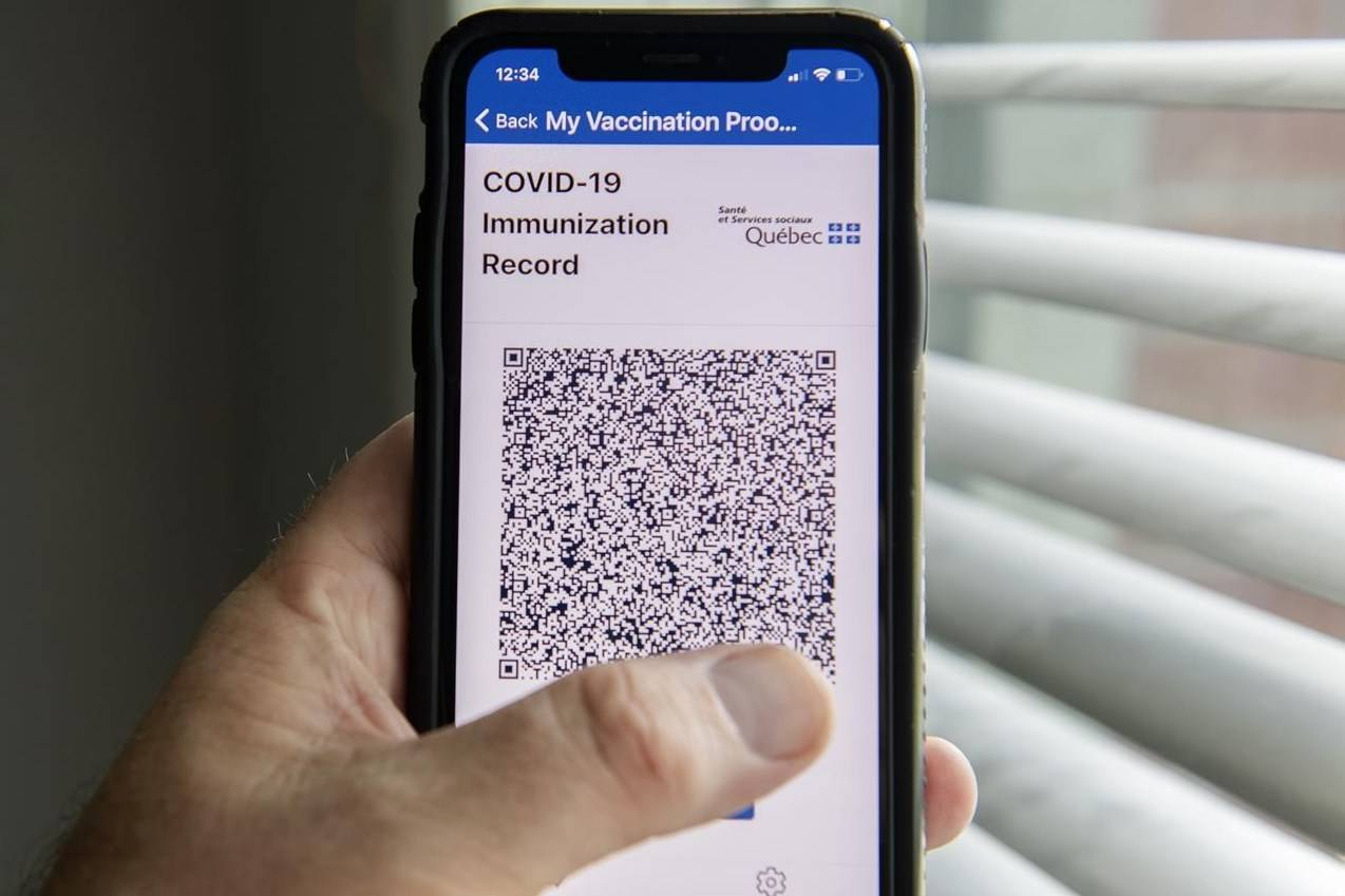 The Quebec government's new vaccine passport smartphone application called VaxiCode is shown on a phone in Montreal, Wednesday, Aug. 25, 2021, as the COVID-19 pandemic continues in Canada and around the world. THE CANADIAN PRESS/Graham Hughes
