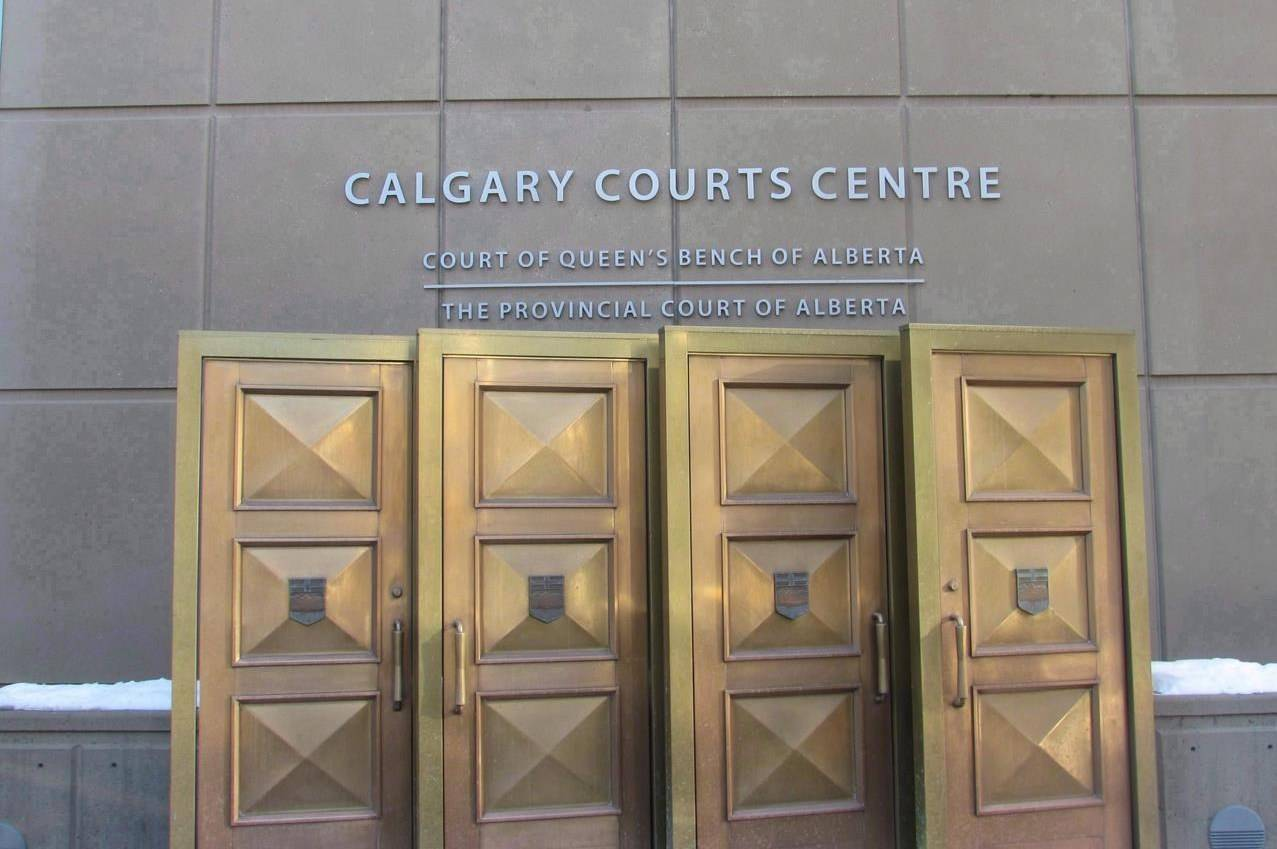 The sign at the Calgary Courts Centre in Calgary, is shown on Jan. 5, 2018. A Toronto man has been handed a fine and is required to cover court costs for taking photos of an Alberta judge and Alberta Health Services lawyer and posting them online. Donald Smith, whose lawyer called him an amateur journalist, appeared by video from Toronto today before Justice Adam Germain. He was fined $1,000 and will be required to pay $1,500 in court costs. THE CANADIAN PRESS/Bill Graveland