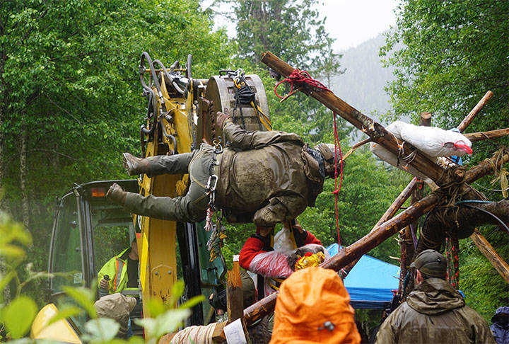 The RCMP use an excavator to extract an old-growth logging protester from a tripod in the Fairy Creek area on Vancouver Island. (Submitted)