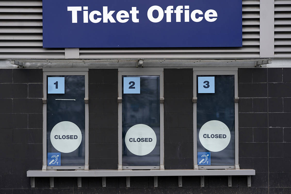 In this March 14, 2020, file photo, a closed ticket office is shown at Etihad Stadium where Manchester City were due to play Burnley in an English Premier League soccer match, in Manchester, England. (AP Photo/Jon Super, File)