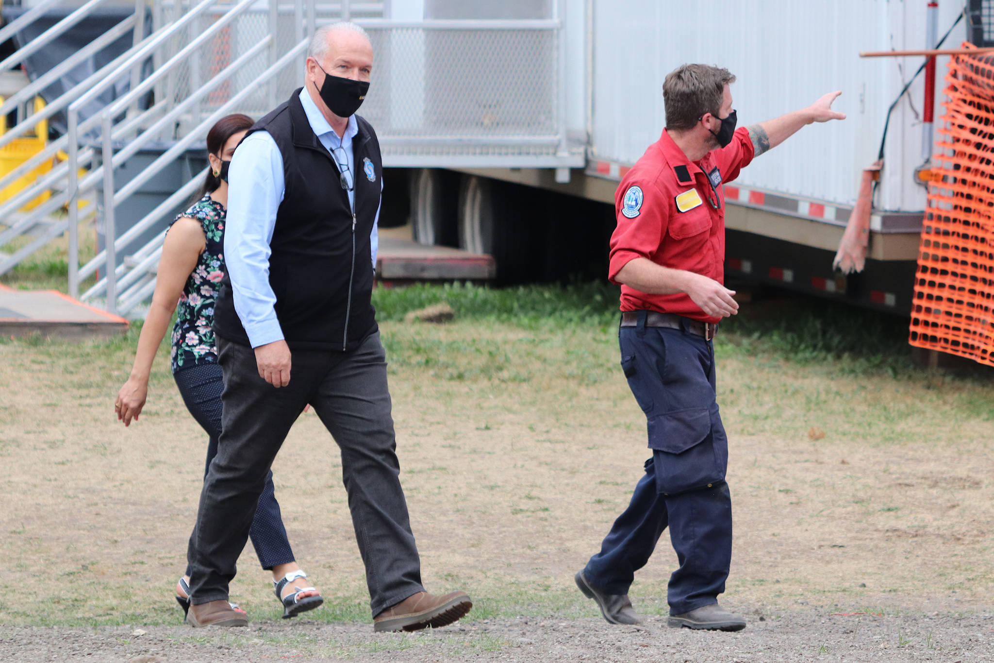 Premier John Horgan tours the BC Wildfire Service camp set up in Vernon Thursday, Aug. 26, where firefighters from all over are stationed while battling the White Rock Lake blaze. (Jennifer Smith - Morning Star)