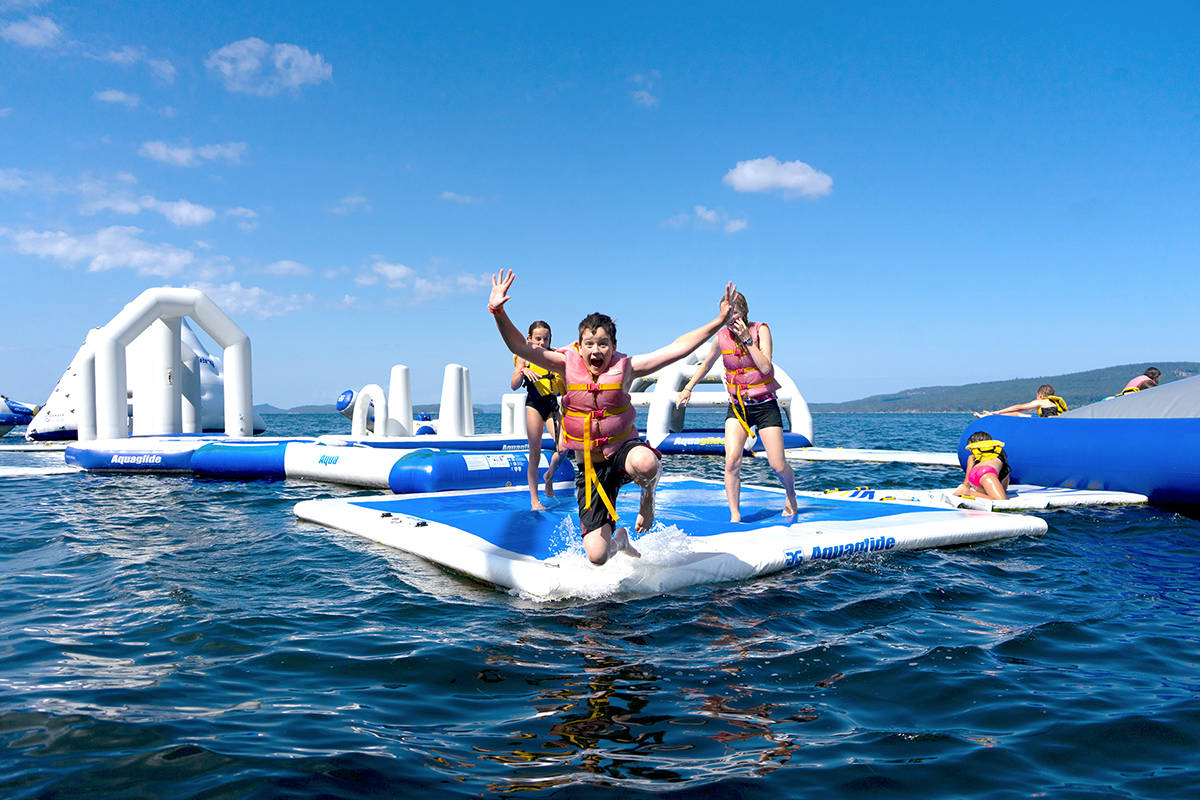 Kids take the plunge at Camp Qwanoes' Aqua Park. (Photo submitted)