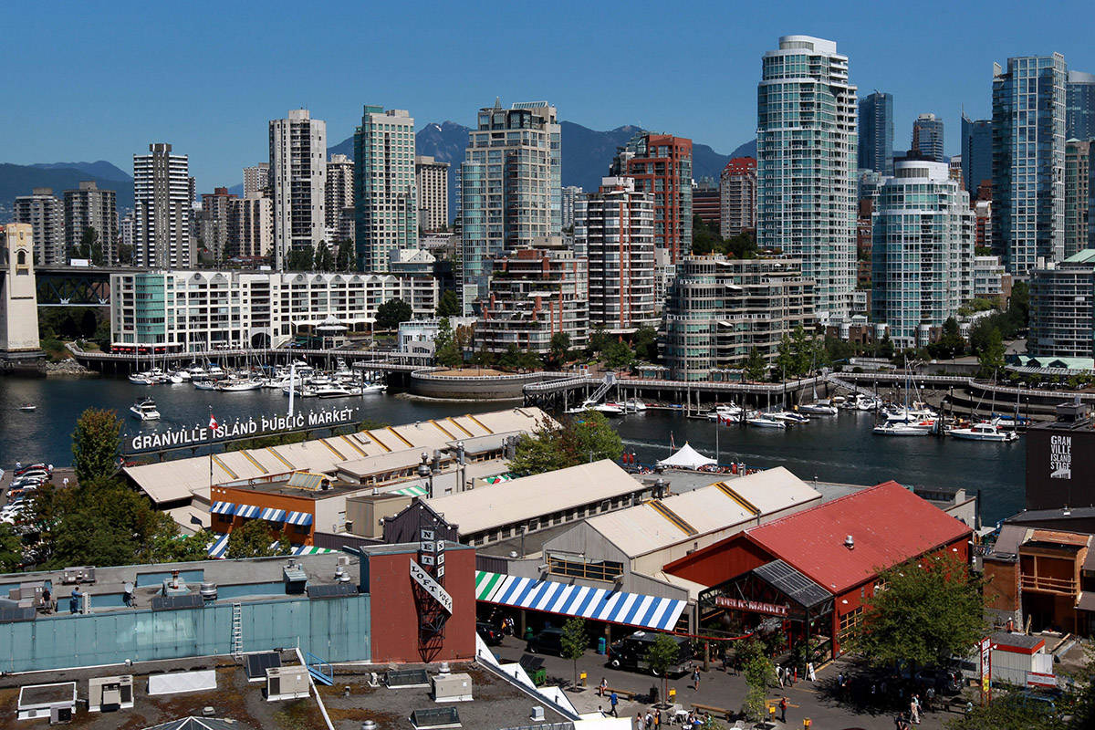 The Granville Island Public Market, bottom, is pictured on the south side of False Creek in Vancouver, B.C., on Monday July 26, 2010. THE CANADIAN PRESS/Darryl Dyck