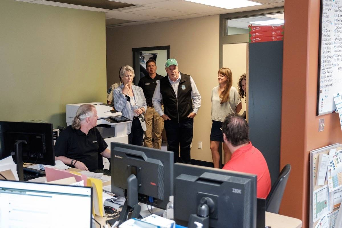 B.C. Premier John Horgan and Forests Minister Katrine Conroy visit B.C. Wildfire Service southeast fire centre in Castlegar, July 21, 2021. This week they toured the North Okanagan and stopped at Logan Lake fire department Friday. (B.C. government photo)