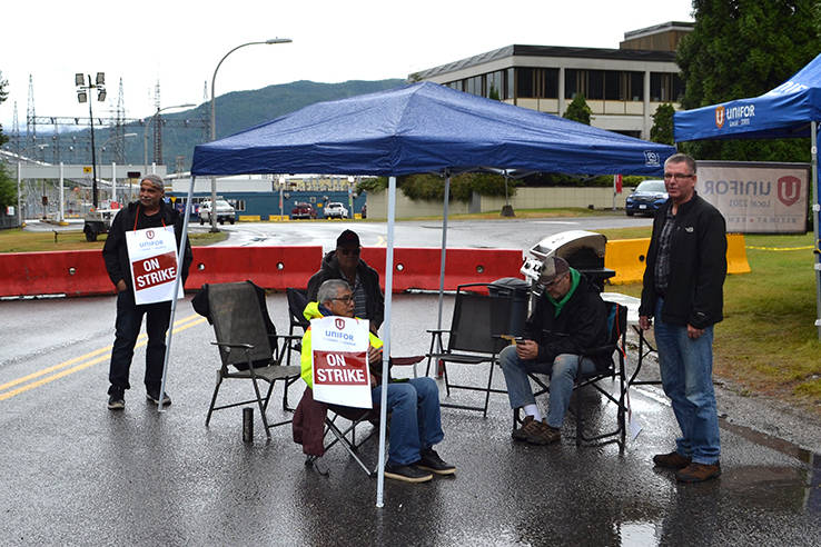 Unifor Local 2301 members outside of the Rio Tinto smelter on July 26, 2021. (Black Press file photo)