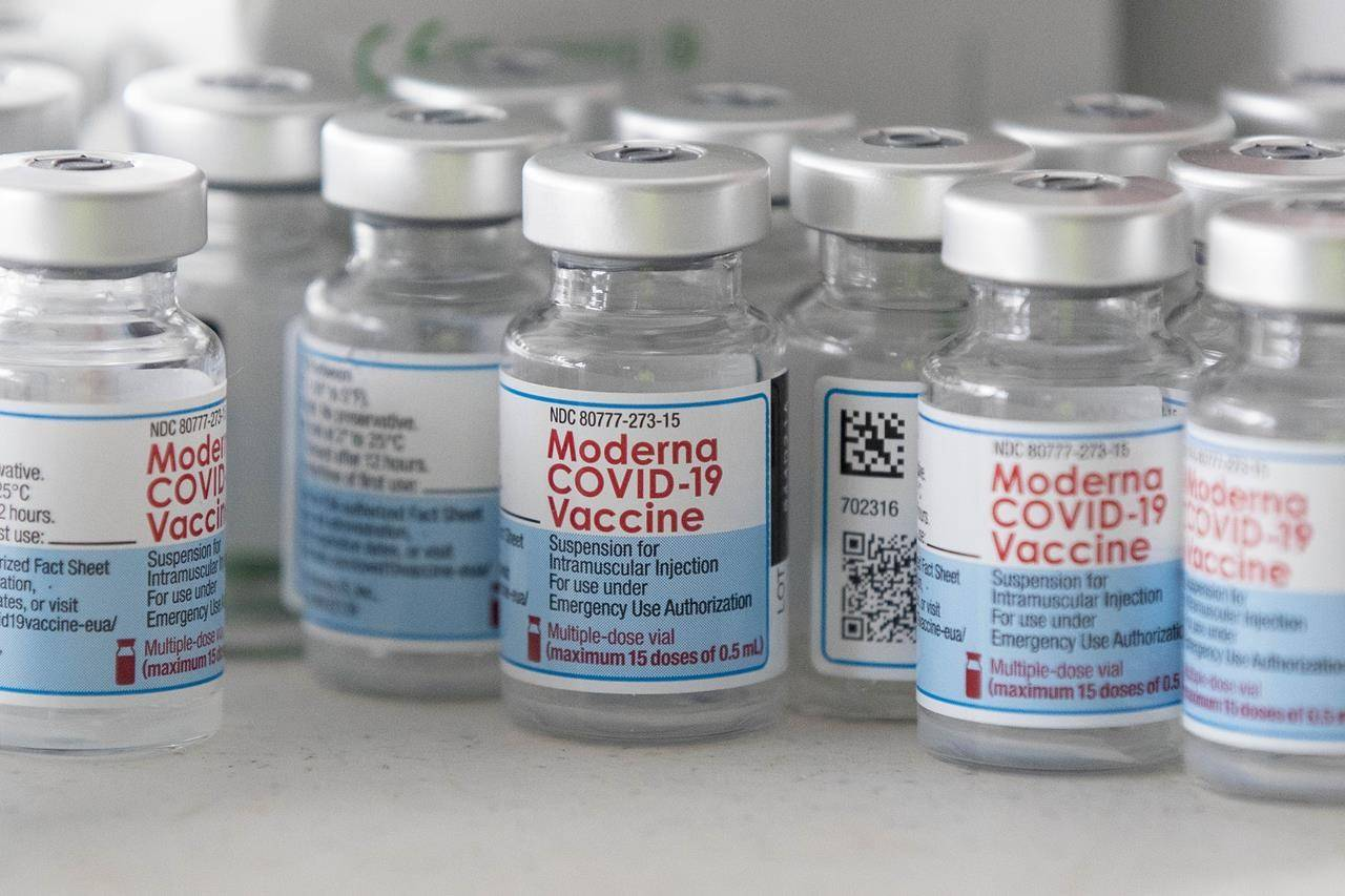 Empty Moderna vaccine vials are shown before a COVID-19 vaccine drive-thru clinic at Richardson stadium in Kingston, Ont., on Friday, Jul. 2, 2021. THE CANADIAN PRESS/Lars Hagberg