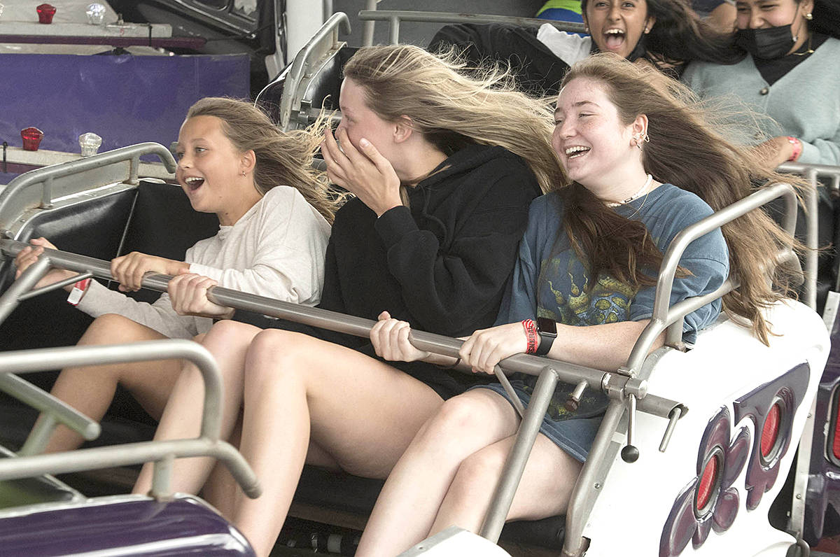 Langley's Avarie Belcourt, 10, Maddie Belcourt, 16, and Brooke Gibson, 15, found their groove riding the Music Express at Playland during opening day of the 2021 PNE Fair FUNdamentals. (PNE'S Craig Hodge/Special to Langley Advance Times)