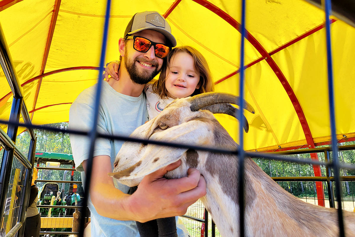 Brandon and Violet Guthrie from Mission got a close-up look at one of the animals from Aldor Acres. (Dan Ferguson/Langley Advance Times)