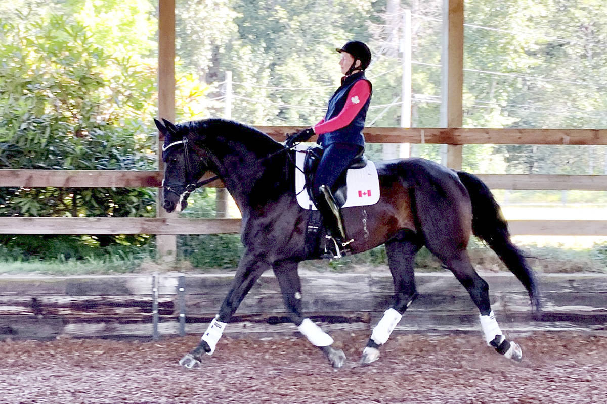 Noni Hartvikson training her farm in South Langley. Riding for Canada, Hartvikson helped boost the team into the top-10 at the Paralympics in Tokyo. (Courtney Palleson/special to Langley Advance Times)