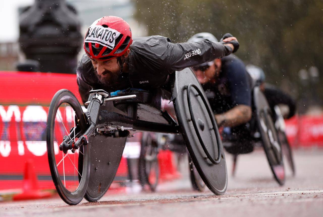 Canada's Brent Lakatos races to win the men's elite wheelchair race at the London Marathon in London, England, Sunday, Oct. 4, 2020. THE CANADIA PRESS/John Sibley/Pool via AP