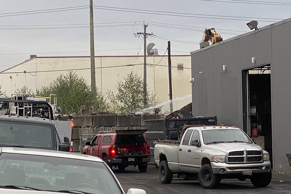 Langley City firefighters were on scene at an industrial area in Langley City early Monday morning, Aug. 30, 2021. There was a report of an explosion followed by black smoke billowing from the scrapyard located at 5771 Production Way. (Joti Grewal/Langley Advance Times)