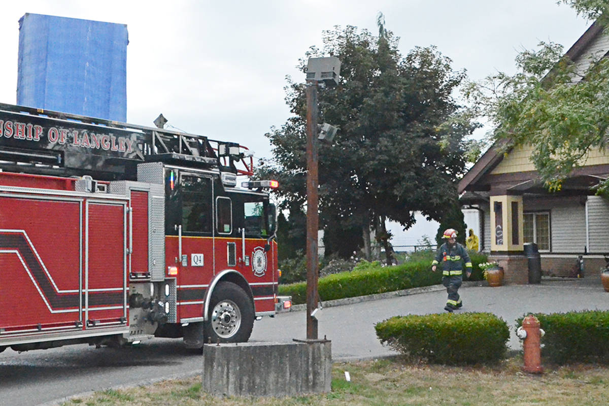 A firefighter at the former Best Value Inn on Glover Road on Monday, Aug. 30. Although there was no fire, an alarm at the site led to one person being taken into custody by the Langley RCMP. (Matthew Claxton/Langley Advance Times)