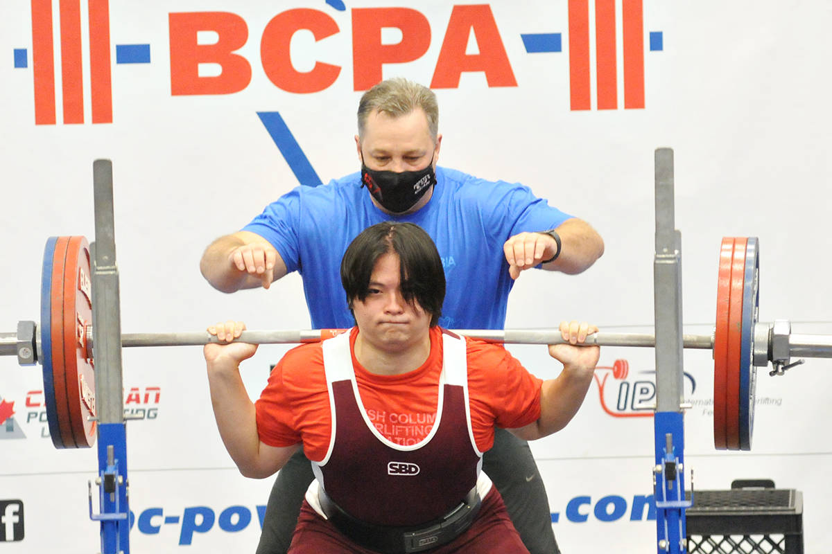 Chun Ki Wayde Chan, with one of three spotters keeping a close eye, completed his squat at the B.C. Powerlifting Association Open on Sunday, Aug. 29, 2021. (Dan Ferguson/Langley Advance Times)