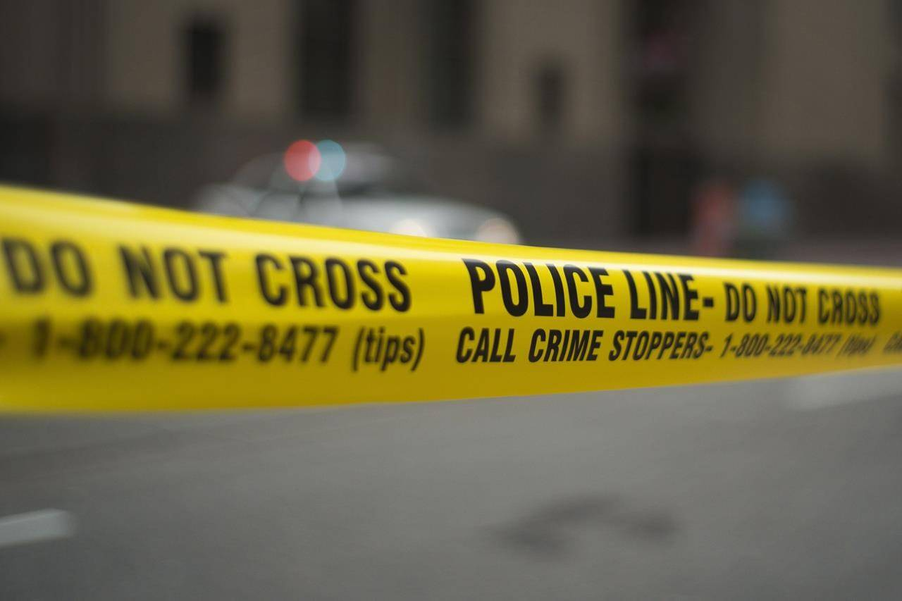 Police tape is shown in Toronto Tuesday, May 2, 2017. THE CANADIAN PRESS/Graeme Roy