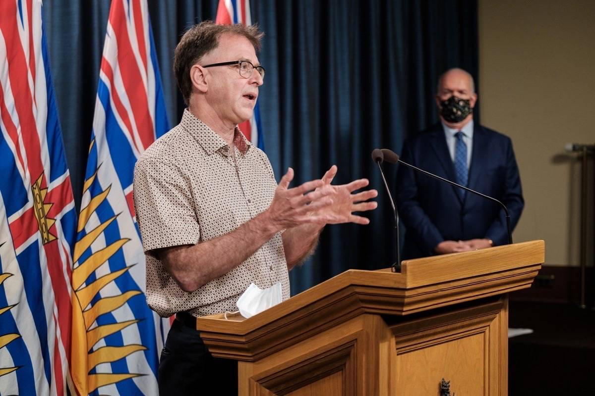 B.C. Health Minister Adrian Dix and Premier John Horgan speak at the B.C. legislature, Aug. 23, 2021. Ending contracted out food and cleaning services in health care was an NDP election promise in 2020. (B.C. government photo)