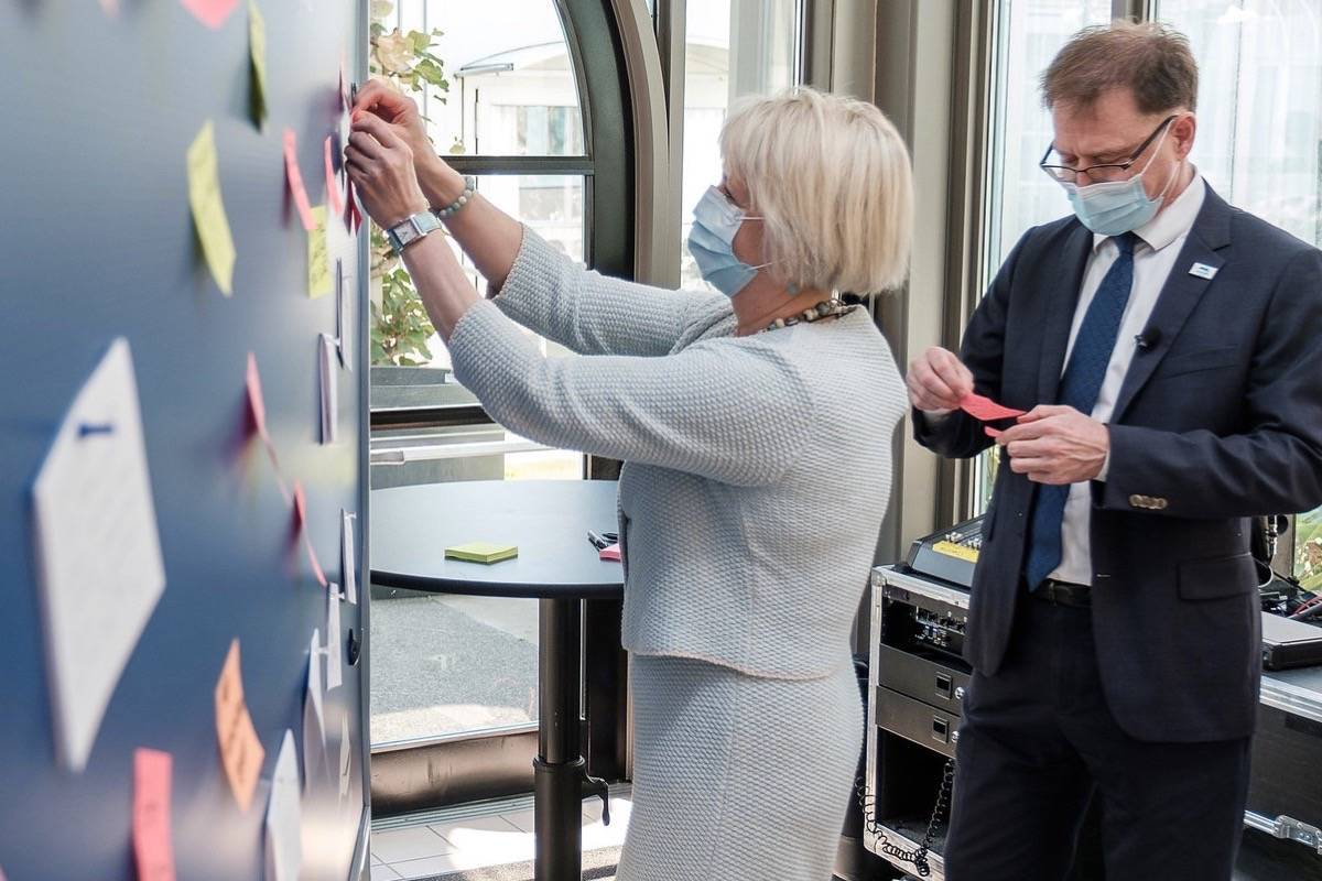 Provincial health officer Dr. Bonnie Henry and Health Minister Adrian Dix add their messages of thanks to staff on a bulletin board at a COVID-19 vaccine clinic in Victoria, Aug. 3, 2021. (B.C. government photo)