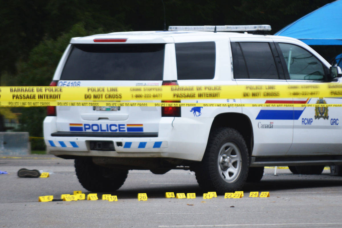 Evidence markers line the parking lot near the Quesnel Seniors' Centre. (Cassidy Dankochik Photo - Quesnel Cariboo Observer)