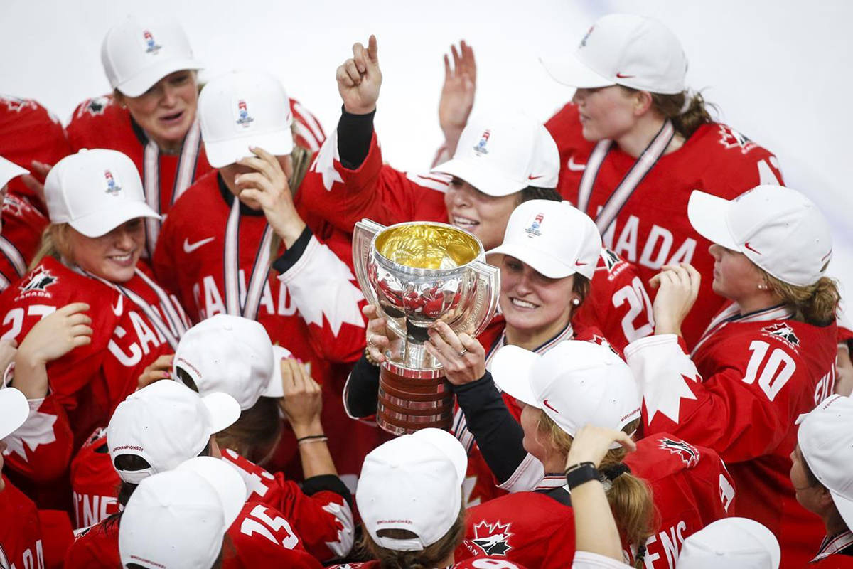 Team Canada's Marie-Philip Poulin, centre, celebrates defeating the United States to win gold at the IIHF Women's World Championship hockey action in Calgary, Tuesday, Aug. 31, 2021.THE CANADIAN PRESS/Jeff McIntosh
