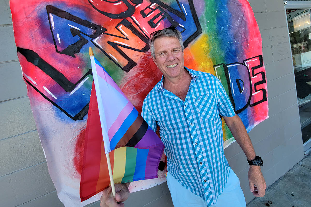 Former Cloverdale—Langley City MP John Aldag, who will be running against current MP Tamara Jansen in the next election, had his picture taken with a pride flag at the second annual Pride event on June 27. (Dan Ferguson/Langley Advance Times)