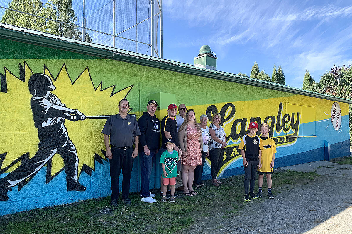 Dan McLaren, Chad Possey, David Patrick with son D.J., artist Judy Pohl, Councillors Rudy Storteboom, Gayle Martin, DLBA executive director Teri James and brothers Carsten and Weston Patrick. (Coun. Rosemary Wallace/Special to Langley Advance Times)