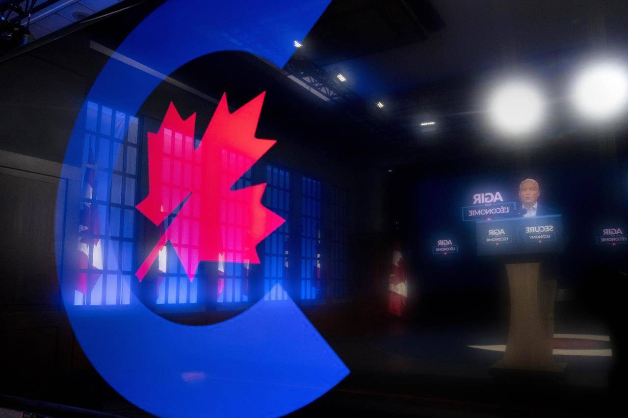 Conservative Leader Erin O'Toole is reflected in the Conservative Party logo on his teleprompter as speaks to the media on Tuesday, Aug. 31, 2021 in Ottawa. Canadians will vote in a federal election Sept. 20th. THE CANADIAN PRESS/Frank Gunn