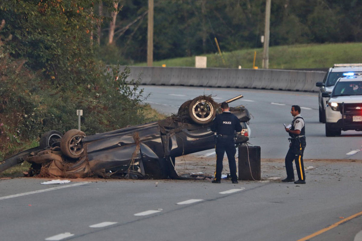 Officers investigated the crash scene in the 25400 block of Lougheed Highway, near Spilsbury Street, after one person was airlifted to hospital on Aug. 31, 2021. (Shane MacKichan/Special to The News)