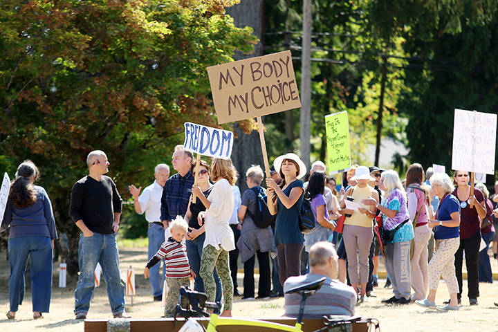 Hundreds of people gathered outside the Cowichan District Hospital on Wednesday afternoon as part of province-wide protests against measures regarding COVID-19. (Kevin Rothbauer/Cowichan Citizen)