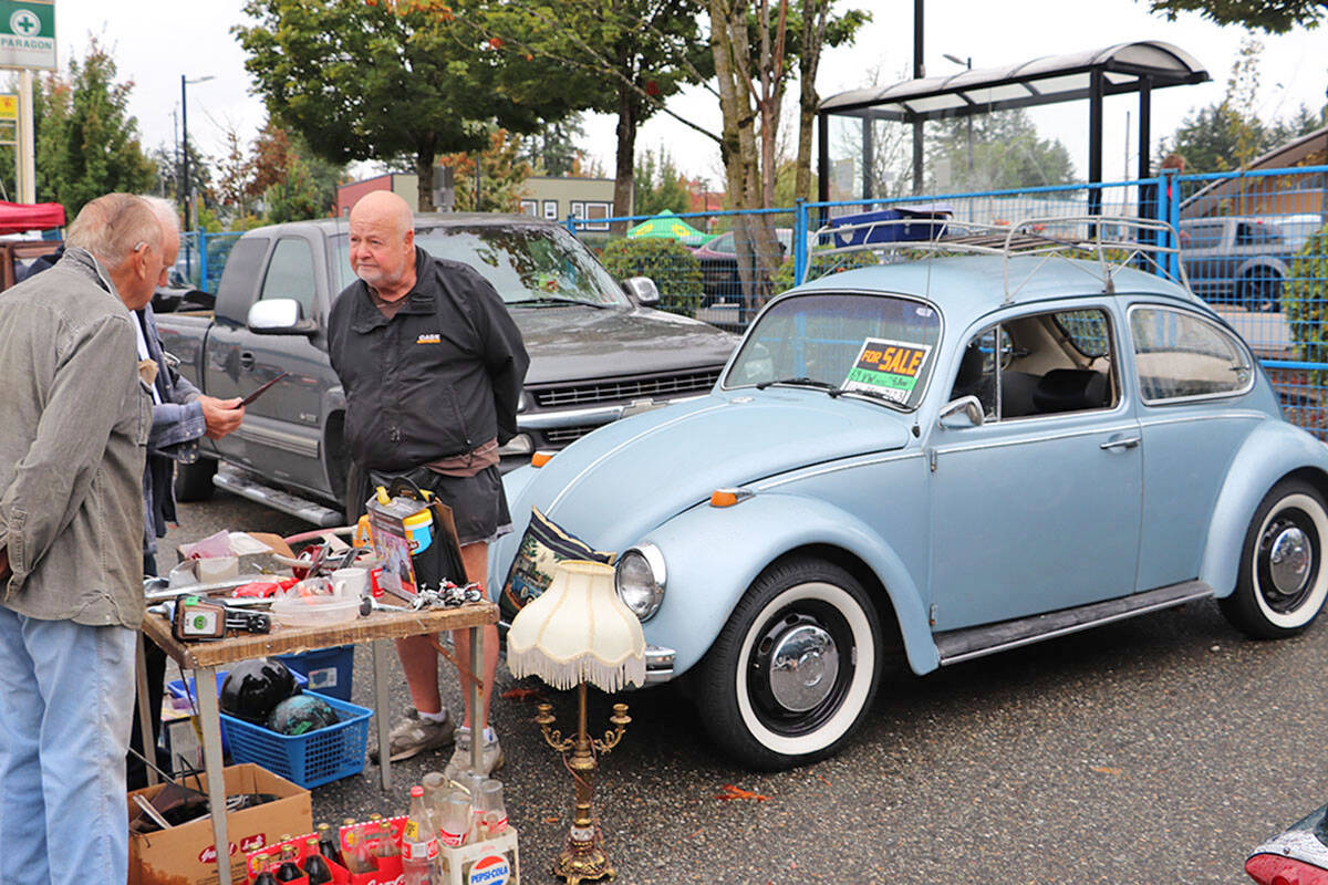 The swap meet and car corral have been longtime features of the Langley Good Times Cruise-In. Sellers and buyers, such as those at the 2019 event, both help bring in additional funds for Cruise-In charities. (Langley Advance Times files)