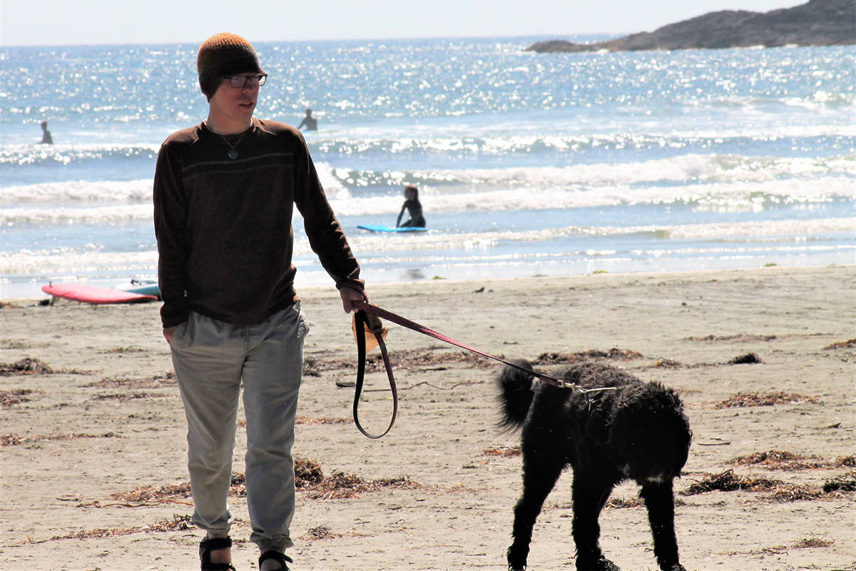 Two-time heart transplant recipient Robbie Thompson, seen here with the family dog, Oreo, explains why mass vaccinations are important for immuno-compromised people like himself. Photo supplied.