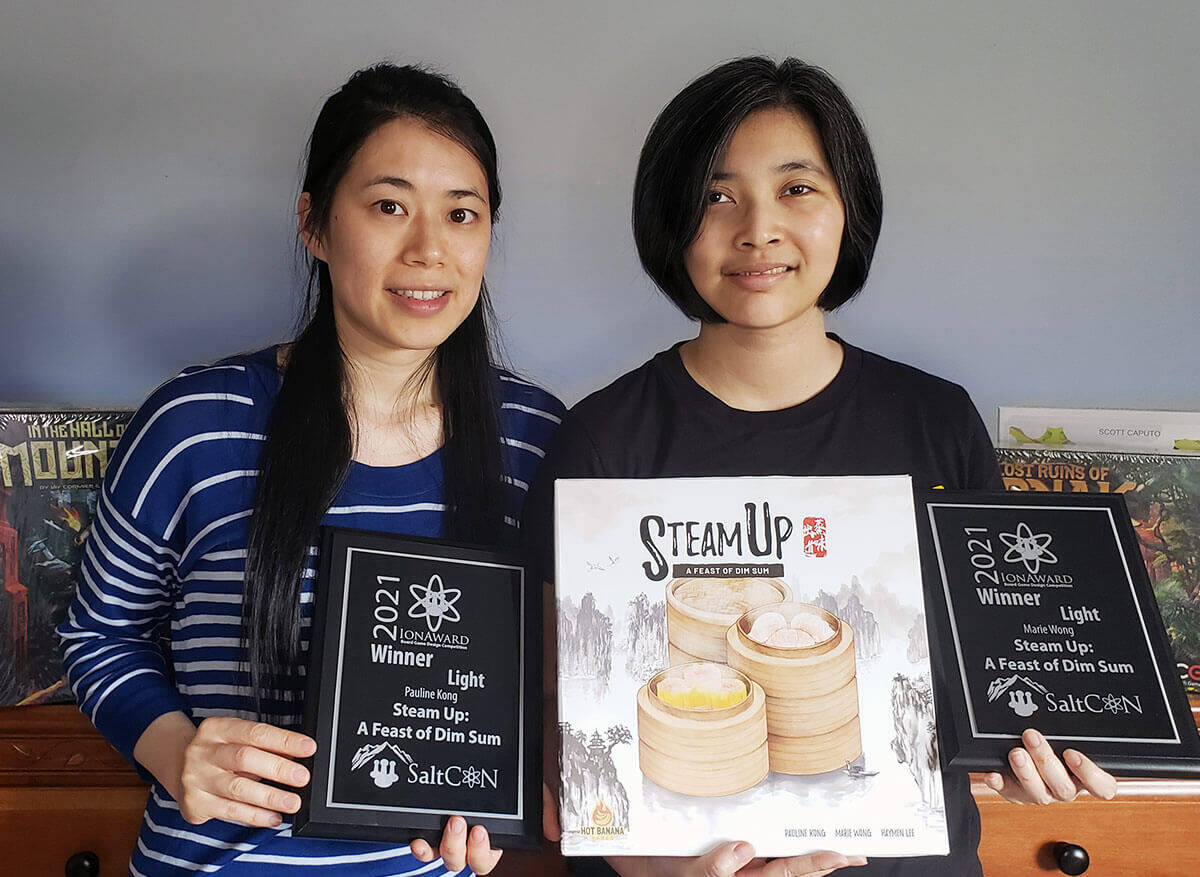 Pauline Kong, left, and Marie Wong created the food-themed board game Steam Up: A Feast of Dim Sum. (submitted photo)