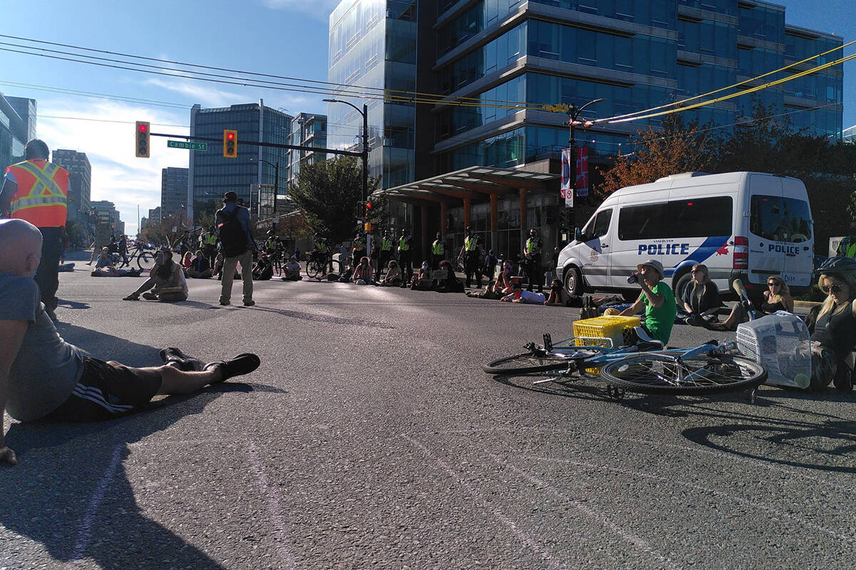 Two protesters were arrested for blocking a roadway in Vancouver during a protest against old-growth logging on Thursday. (Extinction Rebellion/Twitter)