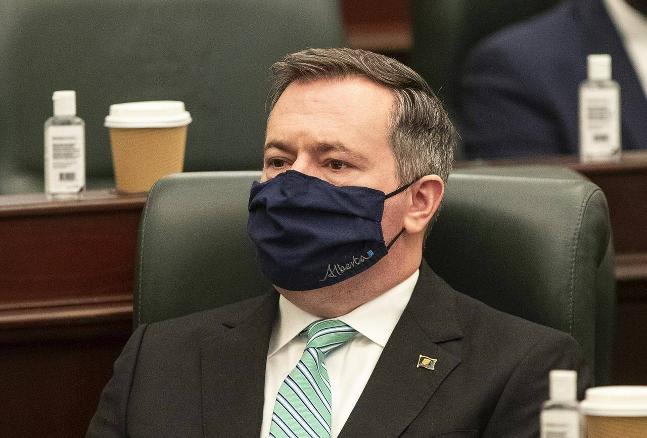 Alberta Premier Jason Kenney listens as the 2021 budget is delivered in Edmonton Alta, on Feb. 25, 2021. Kenney says he remains confident in Alberta's decision to lift COVID-19 safety measures — despite growing concerns from physicians. THE CANADIAN PRESS/Jason Franson